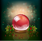 Christmas glass ball with holly and flowers Royalty Free Stock Photo