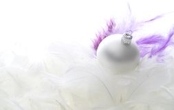 Christmas Glass Ball On Feathers Royalty Free Stock Image
