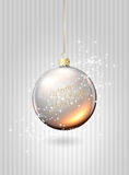 Christmas glass ball over silver background Royalty Free Stock Image