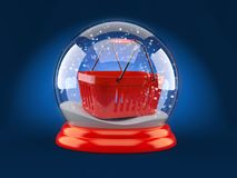 Christmas glass ball with shopping basket. On blue background Royalty Free Stock Photography