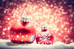 Christmas glass ball in snow. Glitter background Stock Photos