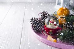 Christmas glass ball with snowman inside. Royalty Free Stock Images