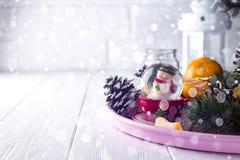 Christmas glass ball with snowman inside. Stock Image