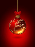 Christmas glass ball with world patternover red Stock Images