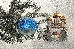 Christmas glass ballon on the background of an Orthodox Church. Christmas. Painting wet watercolor on paper. Naive art. royalty free stock photos
