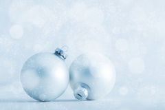 Christmas glass balls on cold frosty glitter background stock photography