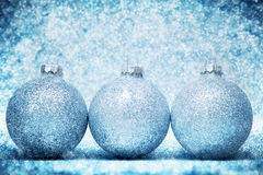 Christmas glass balls on cold frosty glitter background royalty free stock image