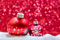 Christmas glass balls in snow. Glitter background Royalty Free Stock Image