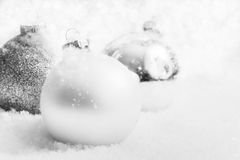 Christmas glass balls on snow, winter background. Christmas white glass balls on snow, winter background, frost, glittering lights Stock Images