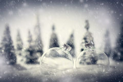 Christmas glass balls in winter miniature forest scenery with snow. Vintage, fairytale mood stock image