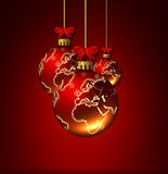 Christmas glass balls with world pattern isolated over red Royalty Free Stock Photography