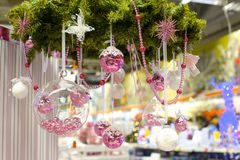 Christmas glass bowl with small pink balls at Royalty Free Stock Photo
