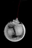Christmas Glass Bulb Ornament. A single glass christmas bulb ornament over black royalty free stock photos