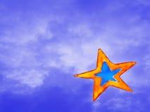 Christmas glass decor star. A christmas star painted on a window glass against a blue cloudy sky Stock Image