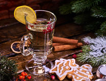 Christmas glass latte mug with lemon and red berry cookies . Christmas glass latte mug and Christmas star form cookies on plate with fir branches. Mug royalty free stock images