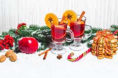 Christmas Glass Of Red Mulled Wine On Table With Cinnamon Sticks, Branches Of Christmas Tree, Snow, Royalty Free Stock Photo