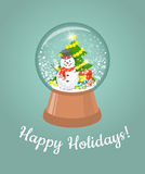Christmas glass snow ball with happy snowman Royalty Free Stock Image
