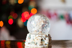 Christmas glass snow globe with a snowman Royalty Free Stock Photo