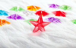 Christmas glass star over winter white fur Royalty Free Stock Photos