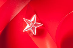 Christmas glass star on red ribbon Stock Photography