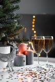 Christmas glasses of champagne with lights on the background royalty free stock photography