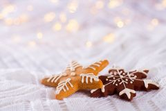 Christmas glazed cookie in form of star and snowflake on light a. Nd warm bokeh background. New year card. Xmas sweets stock image