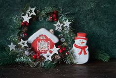 Christmas glazed gingerbread and festive decor. House and snowman Stock Photos
