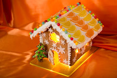 Christmas glazed gingerbread house with sweet pine. Stock Image