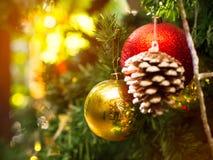 Christmas glister ball on pine tree. Christmas glister ball decorate on pine tree with warm light bokeh Royalty Free Stock Photography