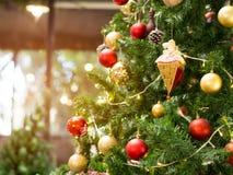 Christmas glister ball on pine tree. Christmas glister ball decorate on pine tree with warm light  bulb for new year celebration Royalty Free Stock Photo