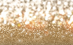 Christmas glitter background. Christmas background of sparkling gold glitter Royalty Free Stock Photo