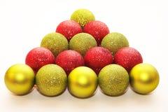 Christmas glitter balls. Color Christmas glitter balls composed like Christmas Tree Royalty Free Stock Images