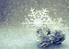 Christmas glitter blurred background, three silver pine cone Royalty Free Stock Photography