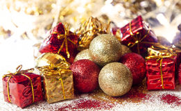 Christmas Glitter Golden and Red Balls and Gift Decoration Royalty Free Stock Images
