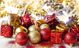 Christmas Glitter Golden and Red Balls and Gifts Decoration Stock Photos