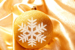 Christmas glitter golden snowflake bauble Royalty Free Stock Photography