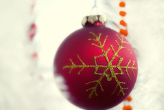 Christmas globe. Red Christmas ornament on white background Royalty Free Stock Photography