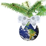 Christmas globe on tree with white bow Stock Photography