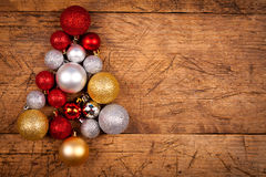 Christmas globes as a tree. Shiny Christmas globes as a tree on wooden table, left side Royalty Free Stock Photo