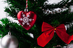 Christmas Globes and Bow in a Christmas Tree Royalty Free Stock Photos