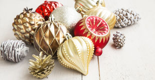 Christmas Globes and Cones. Festive Red and Golden Christmas Globes with Cones Stock Images