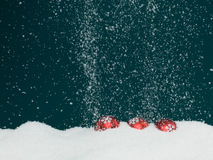 Christmas globes covered in snow Stock Photo