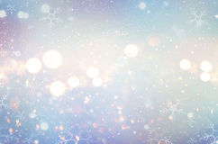 Christmas glow winter background. Defocused snow background. With blinking stars and snowflakes Royalty Free Stock Photo