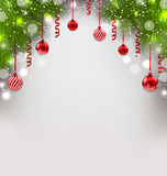 Christmas glowing background with fir branches, glass balls, str Royalty Free Stock Photography
