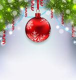 Christmas glowing background with glass ball, fir branches, stre Stock Photography