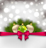 Christmas glowing card with fir branches and glass balls Stock Photos