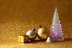 Christmas glowing festive tree and ball decorations Stock Photos