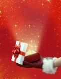 Christmas glowing Magic box. Womans hand holding a Glowing Magic box Royalty Free Stock Photos