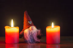 Christmas gnome and the candles Stock Images