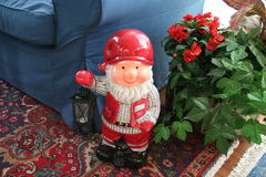Christmas gnome with lantern. Happy Christmas gnome with lantern and cat in front of his feet Stock Photo